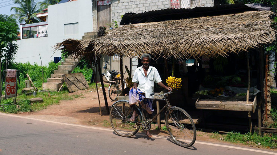 Guy with bicycle Sri Lanka
